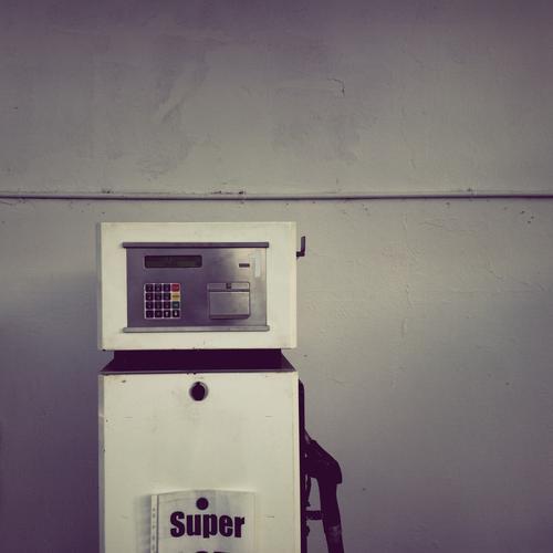 SUPER Technology Hideous Gray Senior citizen Gasoline Petrol station fuel stop Tank Petrol pump Colour photo Subdued colour Exterior shot Deserted