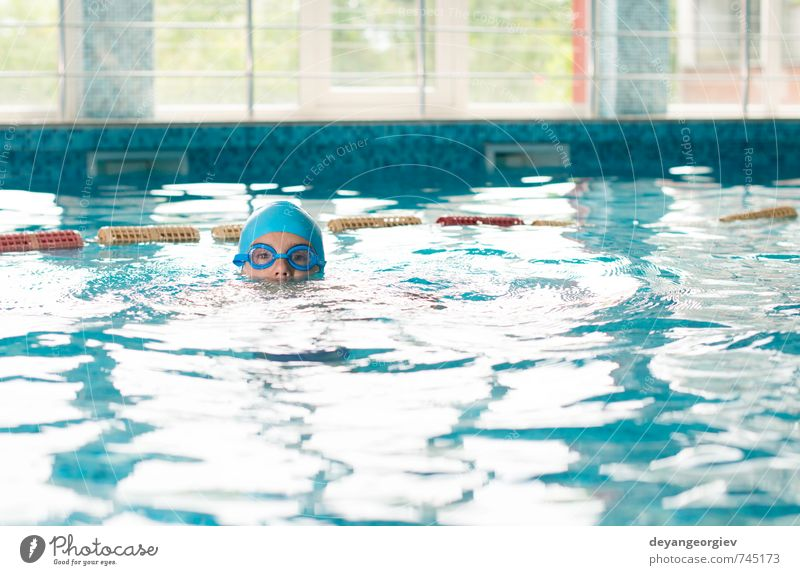 Little boy in swimming pool Joy Leisure and hobbies Playing Vacation & Travel Summer Sports Swimming pool Child School Boy (child) Infancy Smiling Happiness