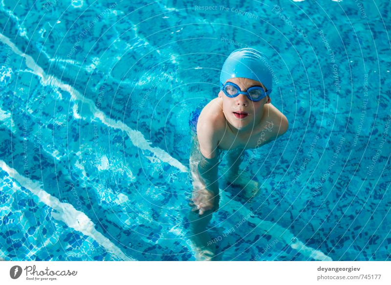 Little boy in swimming poo Child Vacation & Travel Blue Summer Joy Boy (child) Sports Playing Small Happy School Leisure and hobbies Action Infancy Happiness