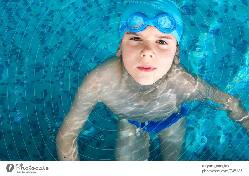 Little boy in swimming pool Joy Happy Leisure and hobbies Playing Vacation & Travel Summer Sports Swimming pool Child School Boy (child) Infancy Smiling