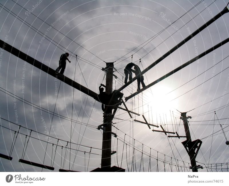 Hanging on the ropes Wire Light Mountaineer Action Safety Trust Power Climbing Sports Sportsperson Rope Sky Sun Electricity Joy fun Brave Fear