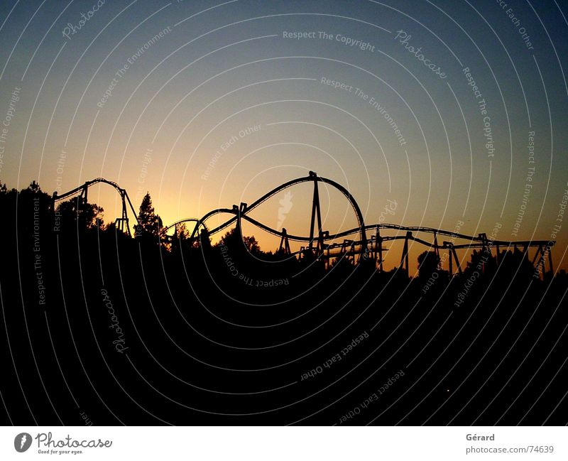 roller coaster ride at sunset Sunset Roller coaster Twilight Visual spectacle Dream contre-jour