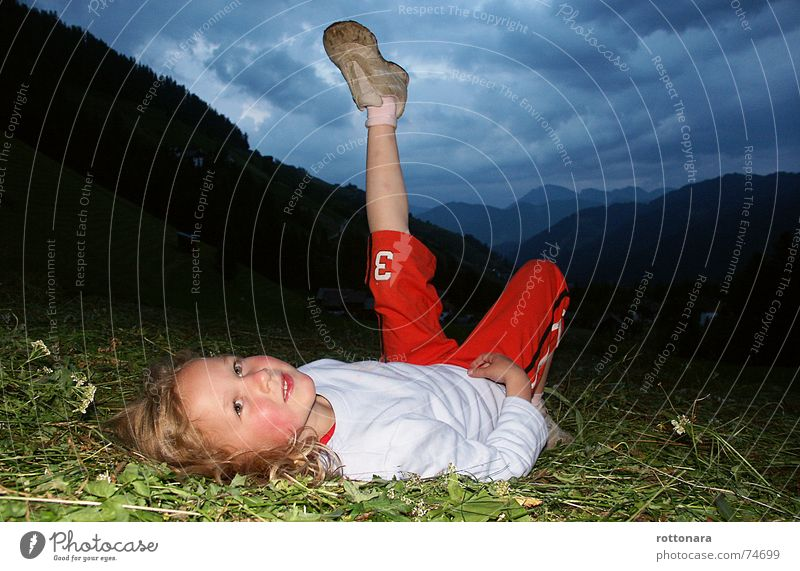 Human being Child Girl Sky Green Blue Red Clouds Dark Meadow Grass Laughter Legs Grinning