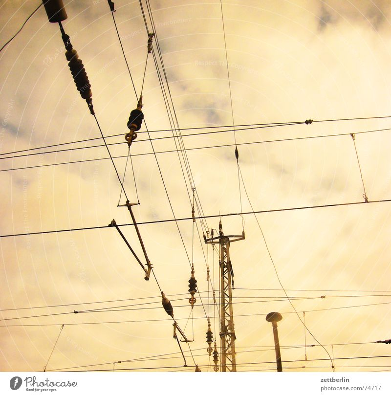 City / Country - The country Overhead line Electricity Railroad Worm's-eye view Clouds Threat Americas electrification e-lok Sky