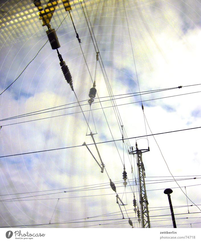 City / Country - The City Overhead line Electricity Railroad Worm's-eye view Clouds Reflection Americas electrification e-lok Sky Window pane