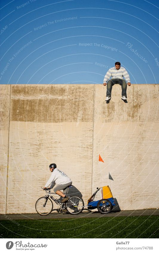 now or never Wall (barrier) Deep Under Bicycle Driving Movement Carriage Jump Sky Human being Sit Looking little scales Followers Brave
