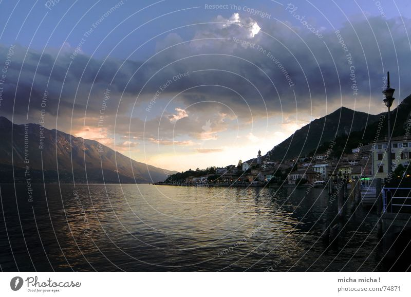 Water Vacation & Travel Calm House (Residential Structure) Clouds Lamp Relaxation Mountain Contentment To go for a walk Italy Serene Lake Garda