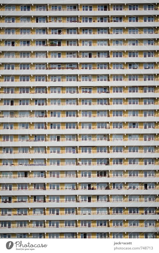Vertical of the panel building Architecture Prefab construction Facade Balcony Stripe GDR Hideous Modern Retro Gloomy Many Style Symmetry Time Equal Detail