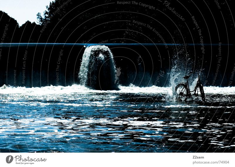 the wheel from the depths Bicycle Stand Isar Bavaria Munich Water Waterfall Barrage River Blue Inject Drops of water Throw Stone