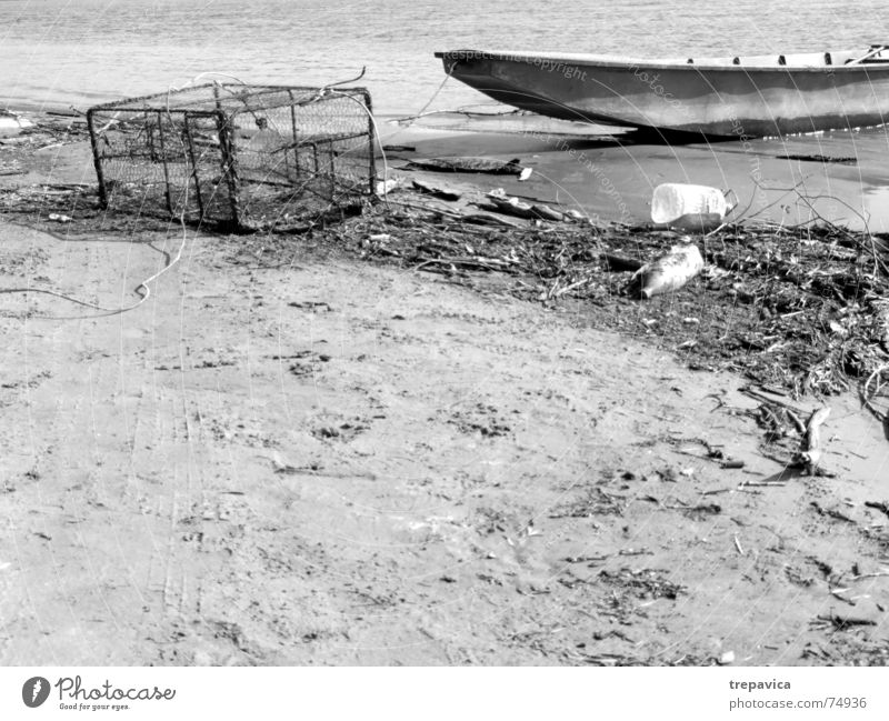 boat Fishing boat Fishery Beach Stranded Calm Fishing net Dirty Empty Black & white photo Boat on the beach Water Danube Sand River die of fish Loneliness