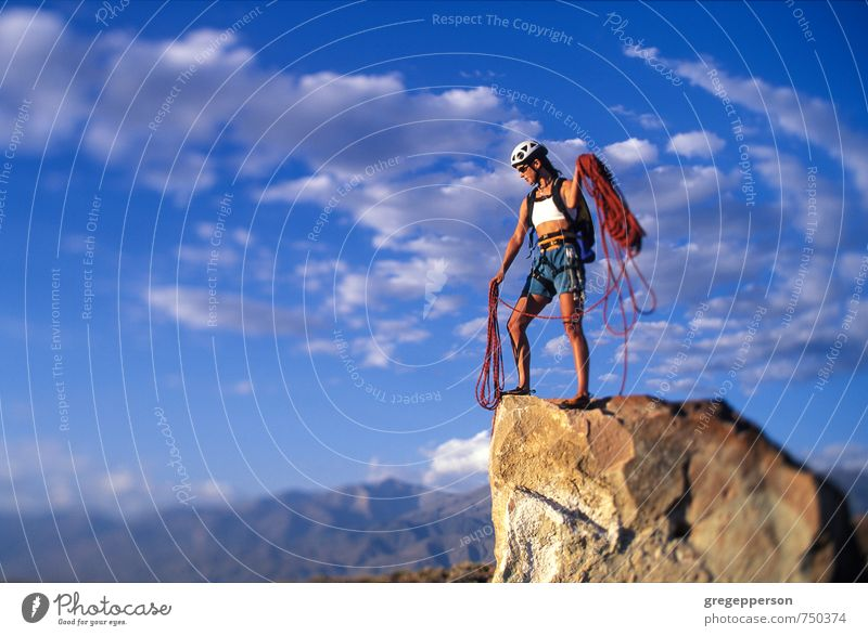 Female climber on the summit. Human being Clouds Adults Feminine Success Adventure Climbing Brave Balance Mountaineering Self-confident Grasp Cliff