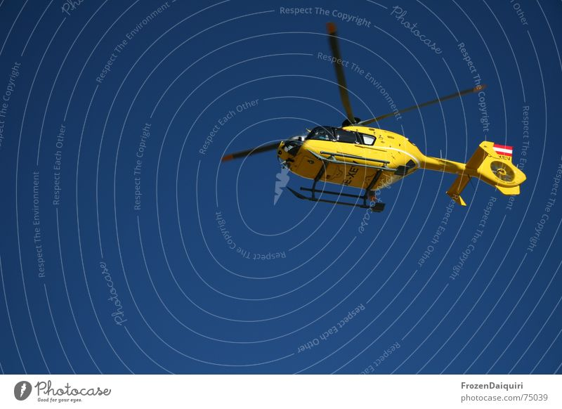 Sky Blue Yellow Flying Aviation Help Rescue First Aid Floating Helicopter Rotor Deployment Lifesaving Rescue helicopter Bright background
