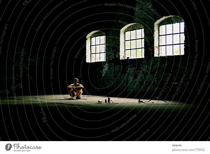 alone in the hall Loneliness Man Window 3 Shaft of light Dark Think Illuminate Cold Cone of light Shard Helpless Duck down Closed Spray can Tagger Dust Grief