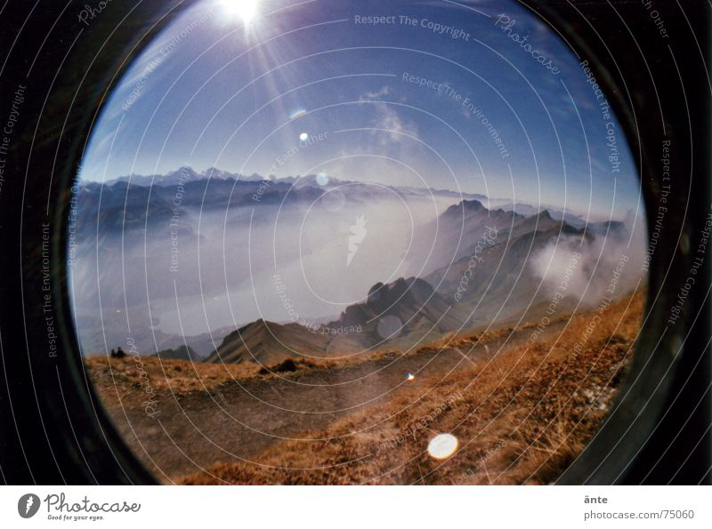 Alpine fairy tale from the fish eye Lake Steam Fog Reflection Dazzle Dry Footpath Leisure and hobbies Distorted Fisheye Lomography Sea of fog Brienzer Rothorn