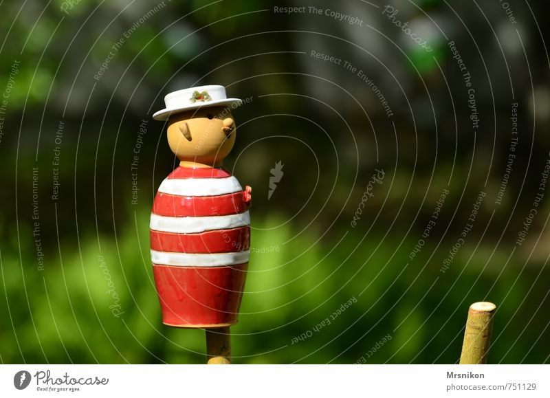 A little man stands in the forest Art Sculpture Emotions Joy Happy Happiness Contentment Spring fever Clay tonkunst Pottery Figure Red White Striped Doll Hat