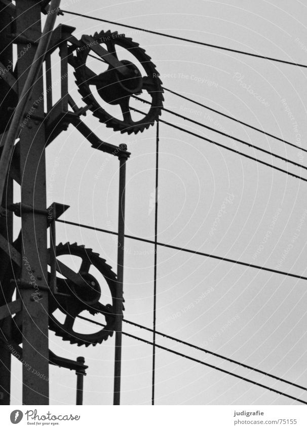Voltage Railroad system Mechanics Electricity Steel Connectedness Construction Black White Gray Technology Gearwheel Cable Transmission lines Electricity pylon