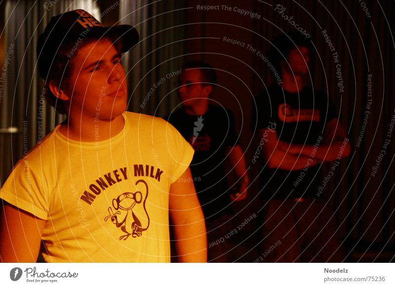 big head Concert Light Portrait photograph Moody Yellow Red Baseball cap Lighting Human being T-shirt