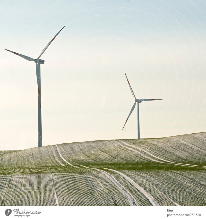 greenEnergy Energy industry Wind energy plant Field Hill Rotate Green Movement Future Pinwheel Line Snowfall Frost Winter Exterior shot Deserted Copy Space top