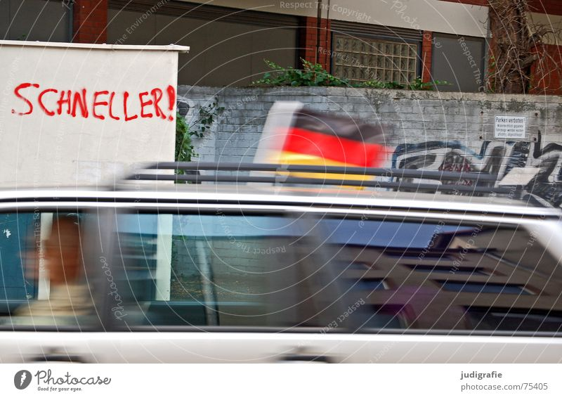 Faster II Speed Wall (building) Wall (barrier) Driving Driver Typography Hannover Black Red Flag Flash Transport Motor vehicle Town Reflection Facade Building
