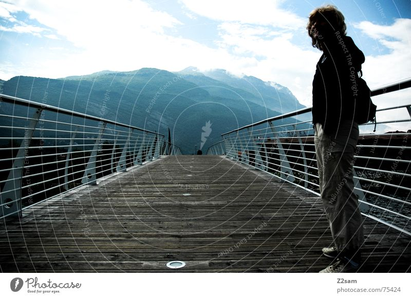 on bridges Woman Stand Above Going Wood Italy Lake Garda Human being Mountain Sky Sun way Lanes & trails Handrail Water
