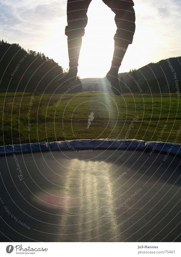 departure Jump Hop Trampoline Abdomen Pants Stockings Black Forest Meadow Evening sun Athlete Life Aloof Beginning Departure jumping sheet Legs Feet Sun Power