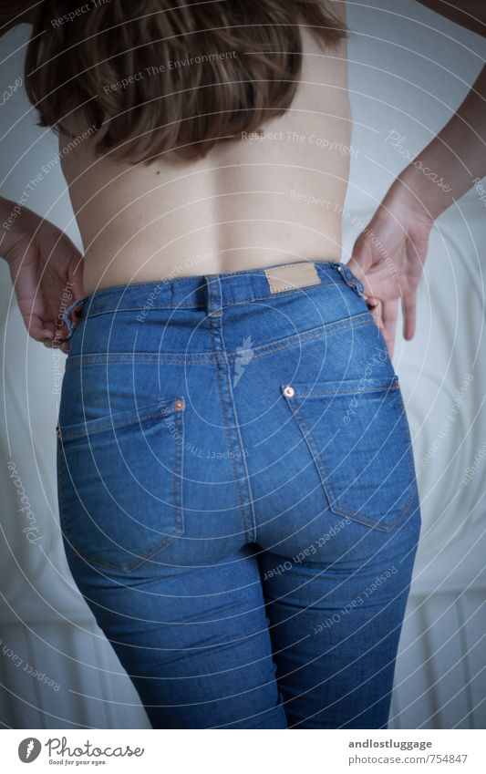 blue jeans. Style Feminine Young woman Youth (Young adults) Back Bottom 1 Human being 18 - 30 years Adults Fashion Jeans Brunette Long-haired Touch To hold on