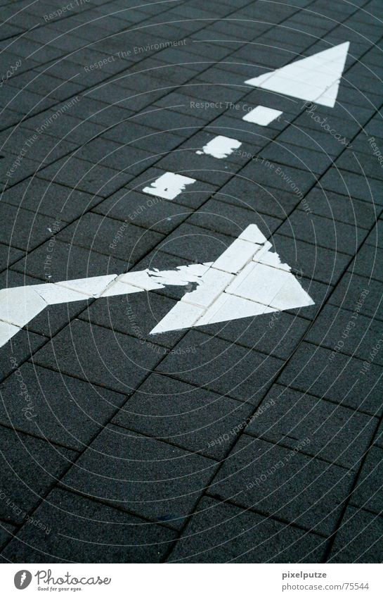 White Street Above Stone Transport Floor covering Shows Arrow Sign Under Direction Conduct Escape Left Paving stone Right
