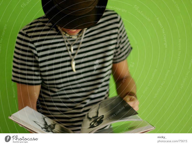 Human being Man Hand White Green Black Wall (building) Wall (barrier) Arm Book Stripe T-shirt Hat Chain