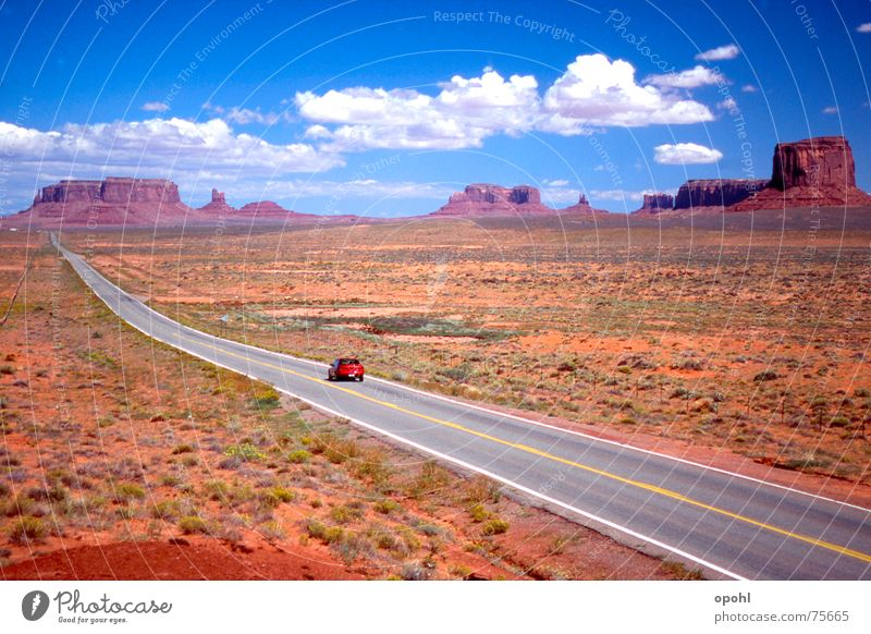 Monument Valley Utah Arizona Golden section Infinity Red rock canyon Clouds Vacation & Travel Wild West Nature USA Street Sky marlboro country