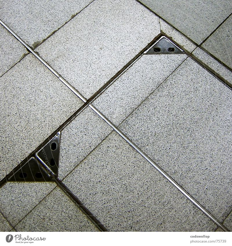 a grand day out Dance floor Gray Steel Gully Black Triangle Square Rectangle Geometry Success Train station Traffic infrastructure Floor covering tiles Tile
