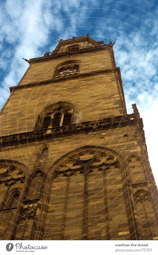 The Solitary Guardian Church spire Building Masonry Wall (barrier) Window Romance Clouds Religion and faith Deities Arch Worm's-eye view Under Sandstone Brown