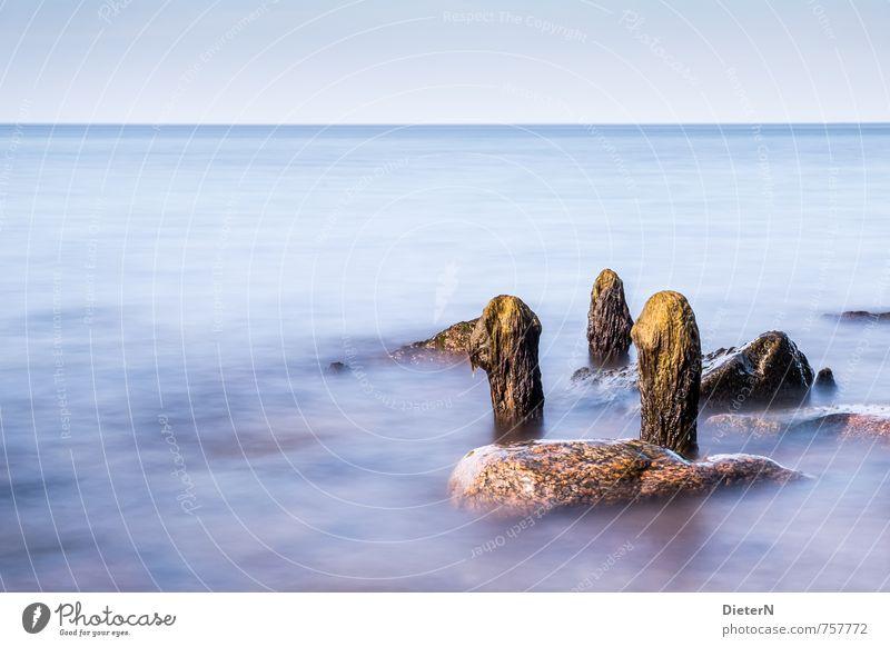relics Landscape Water Sunlight Coast Beach Baltic Sea Ocean Blue Yellow Break water Stone Long exposure Horizon Sky Colour photo Exterior shot Deserted