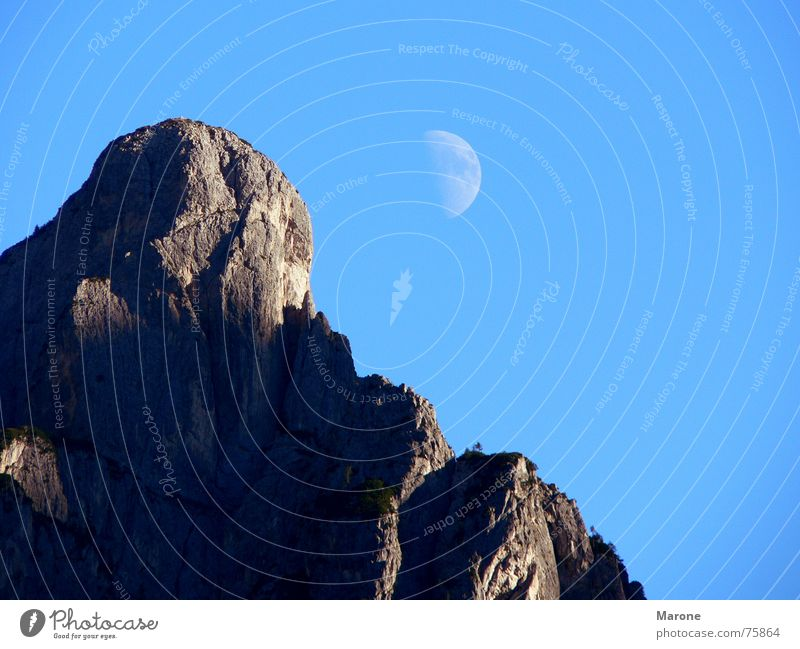 Moonrise on the mountain Half moon Crescent moon Mountain ridge Weightlessness Dolomites Mountain range Celestial bodies and the universe Above ridges Rock Sky