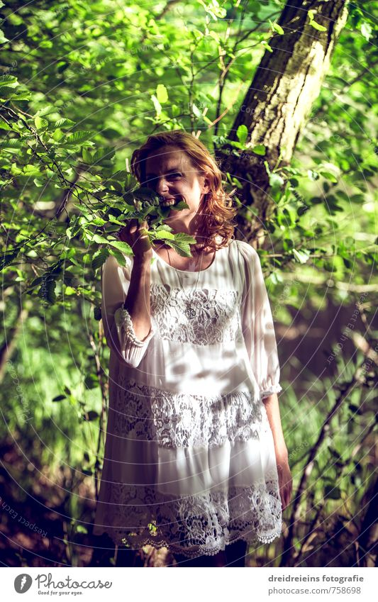 I'm hungry, so I bite the leaves. Joy Happy Human being Feminine Young woman Youth (Young adults) 1 Nature Plant Beautiful weather Fashion Dress Touch