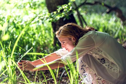 The photographer at work Human being Feminine Young woman Youth (Young adults) 1 Nature Plant Beautiful weather Grass Foliage plant Dress Observe Discover Sit