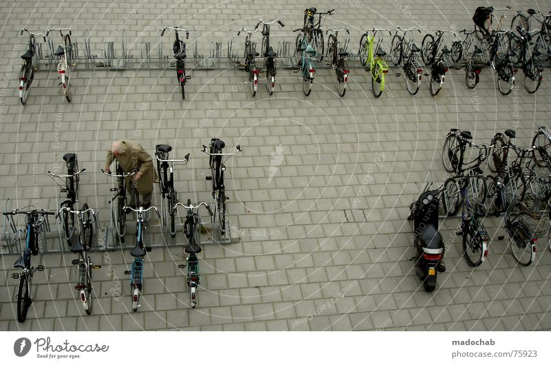 NO WACH?! Bicycle Bicycle lot Human being Life Parking Town Asphalt Gray Under Pedestrian Transport Gloomy Pattern Background picture Structures and shapes