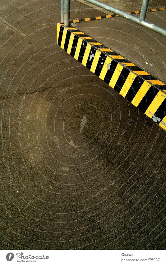 Black Yellow Street Signs and labeling Corner Asphalt Pavement Striped Tar