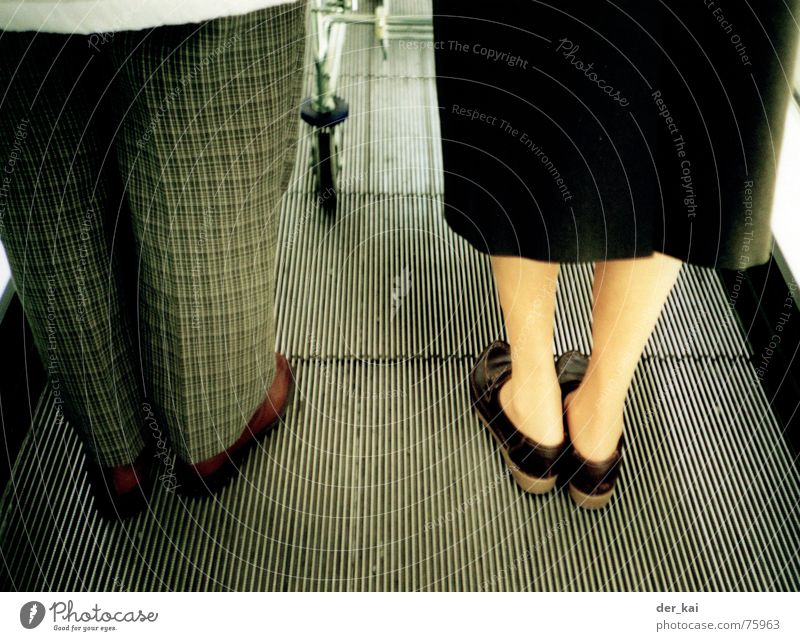 Legs Feet Pants Female senior Male senior Anonymous Married couple Section of image Partially visible High heels Escalator Unrecognizable Footwear Unidentified