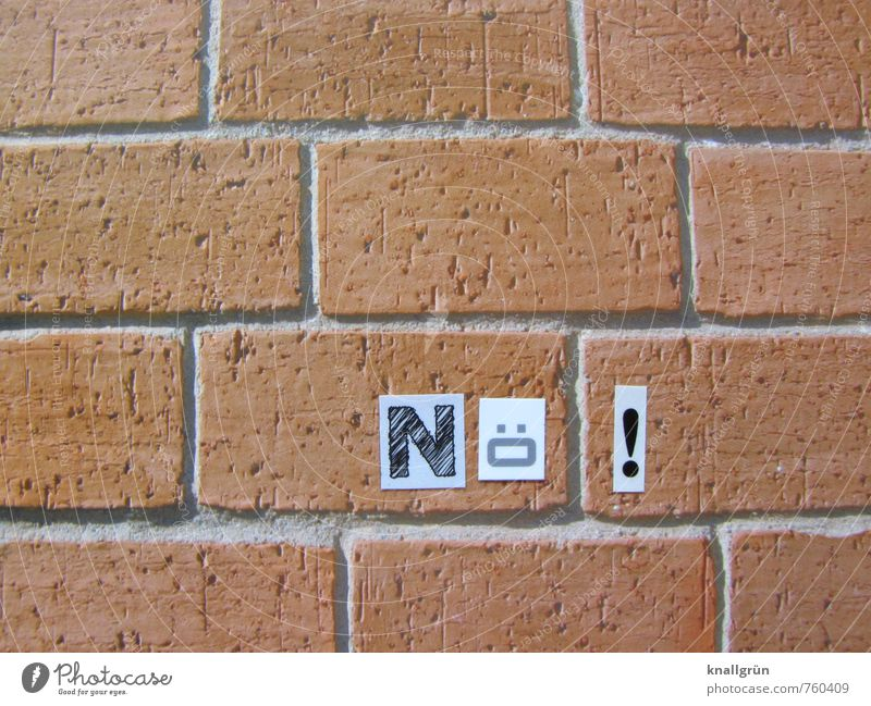 Nope! Wall (barrier) Wall (building) Brick Sign Characters Communicate Sharp-edged Rebellious Town Brown Black White Emotions Moody Cool (slang) Willpower