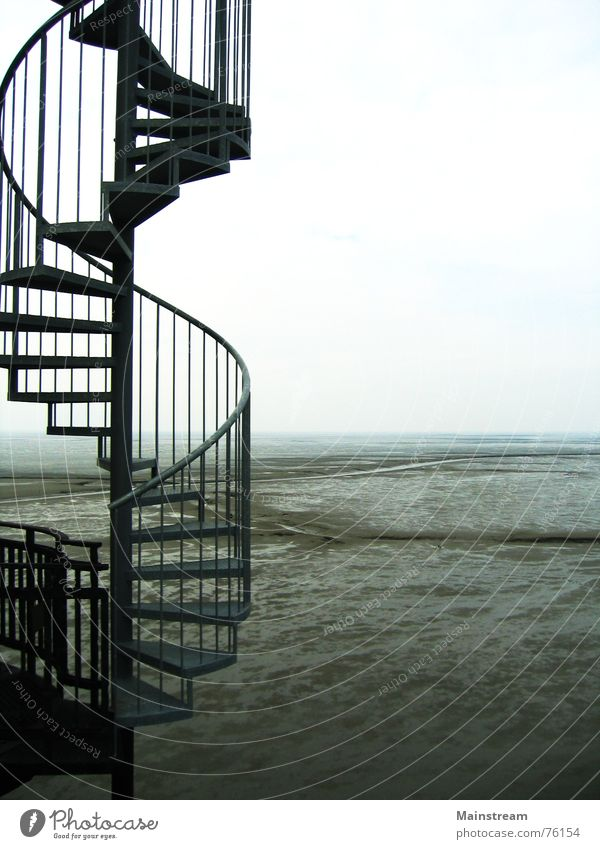 Stairs to the sea Winding staircase Ocean Horizon Water Mud flats Architecture