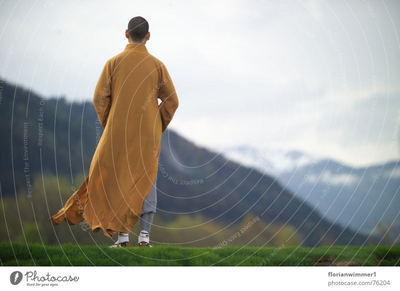 Shaolin monk in the wind Religion and faith Meditation Austria Chinese martial art Monk Wind Mountain Vantage point Nature
