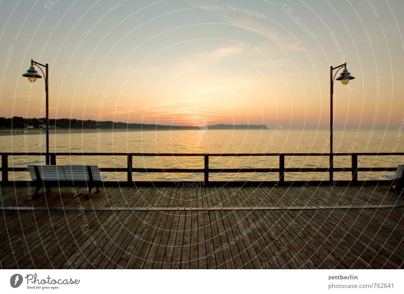 Sky Vacation & Travel Ocean Relaxation Calm Far-off places Horizon Island Handrail Street lighting Lantern Baltic Sea Longing Serene Footbridge Jetty