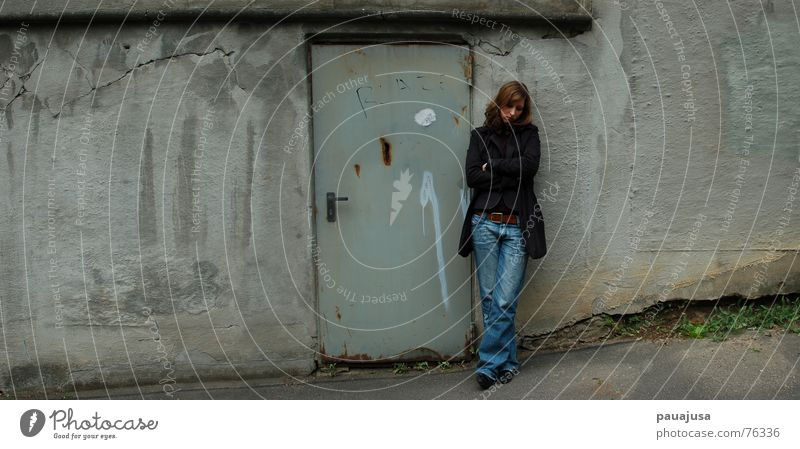 Woman Loneliness Wall (building) Gray Sadness Wall (barrier) Think Wait Dirty Adults Door Grief Jeans Rust Crack & Rip & Tear Plaster