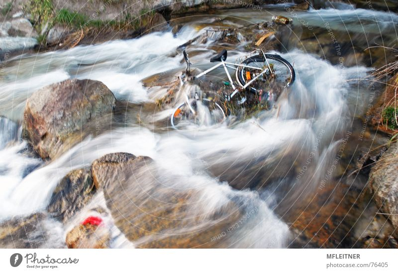 there is a bicycle in the river Federal State of Tyrol Austria water austira motion tyrol