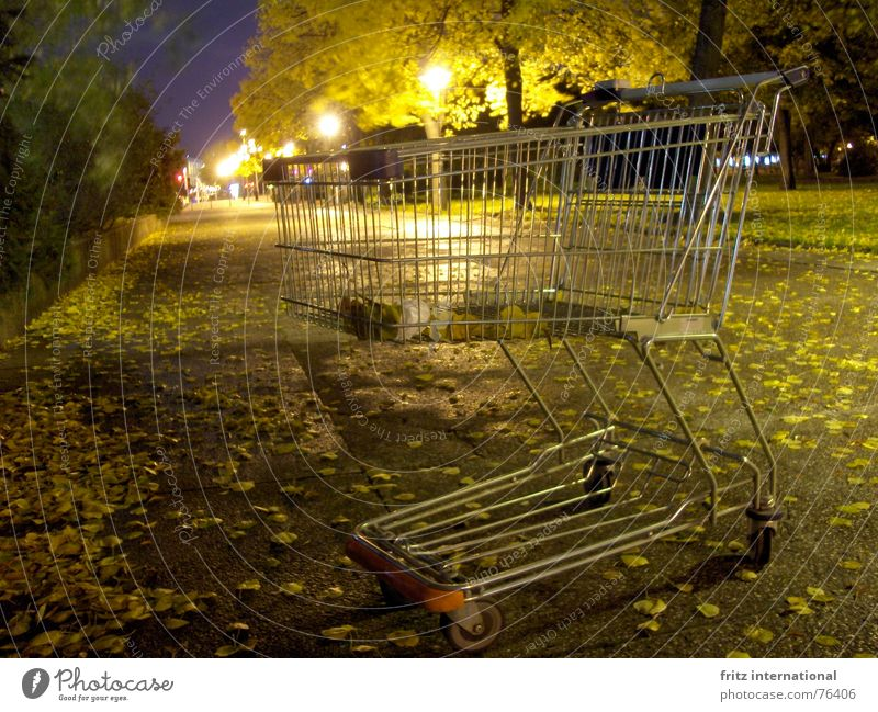 24h shopping Calm Closing time Autumn Leaf Town Deserted Shopping Trolley Gloomy Loneliness Lantern Berlin Obscure Sidewalk Street Lanes & trails Empty