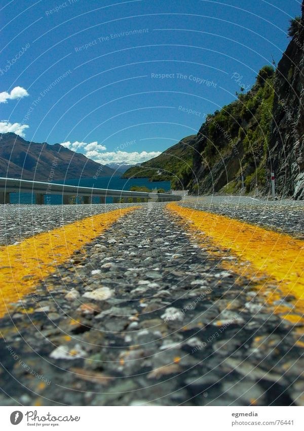 road to beauty New Zealand Queenstown Lake Yellow Country road Traffic lane Sky Pavement Asphalt Lakeside Street Summer Traffic infrastructure Joy wakatipu Blue
