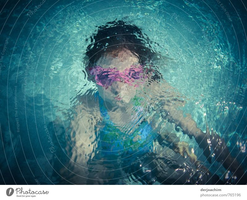 Girl under water with pink diving goggles and the sun is shining. -diving mouse - Joy Athletic Life Vacation & Travel Aquatics Swimming & Bathing Swimming pool