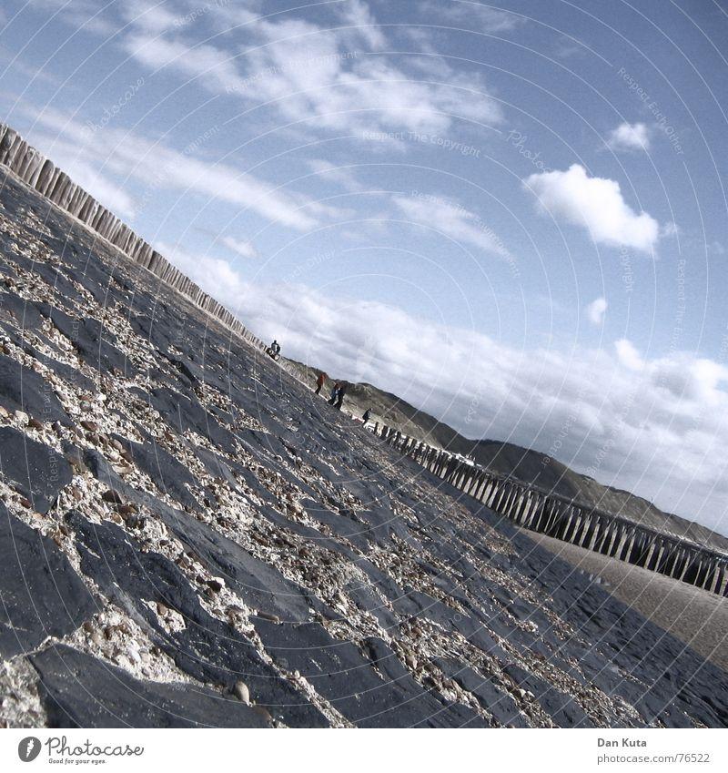 Let it go diagonally! Zoutelande Netherlands Zeeland Background picture Warped Mortar Beach Clouds Coast Beach dune Stone piller firecracker Pole Sand Sky Tilt