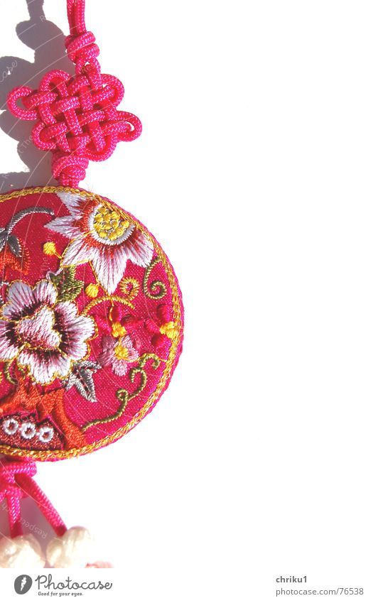 appendage Cloth Pink Keyring Multicoloured String Muddled Gaudy Pattern Exterior shot Asia Kitsch tand Knot Macro (Extreme close-up)