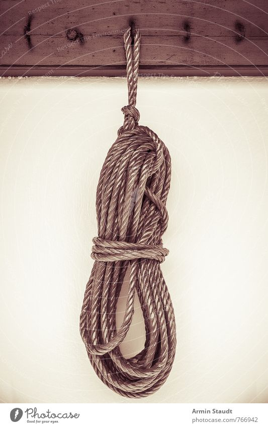 Ariadnes tool Wall (barrier) Wall (building) Rope Clothes peg Checkmark Knot Bundle Suspended Loop Hang Old Authentic Gloomy vintage Retro Color filter Sepia